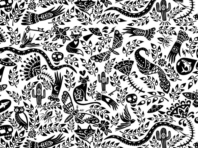 Slideshow image by Jessica Woodward - printed black and white pattern showing leaves, skulls, cats, insects, moths, hands, birds, sharks, cactus, snakes, UFOs and foxes.